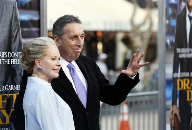 Director of the movie Ivan Reitman and his wife Genevieve pose at the premiere of ''Draft Day'' in Los Angeles, California April 7, 2014. REUTERS/Mario Anzuoni