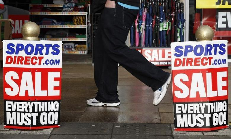 A pedestrian walks past a branch of Sports Direct in Liverpool northern England December 15, 2011. REUTERS/Phil Noble