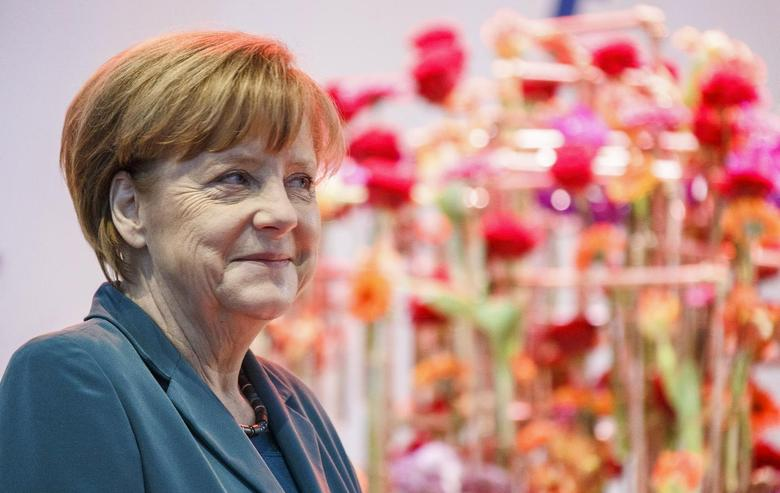 German Chancellor Angela Merkel smiles during their opening tour at the ''Hannover Messe'' industrial trade fair in Hanover April 7, 2014. REUTERS/Morris Mac Matzen
