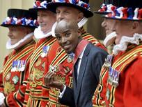 Britain's double Olympic champion Mo Farah poses with his Commander of the Order of the British Empire (CBE) medal, after being presented with it by Prince Charles during an investiture ceremony at Buckingham Palace in London June 28, 2013. REUTERS/John Stillwell/pool