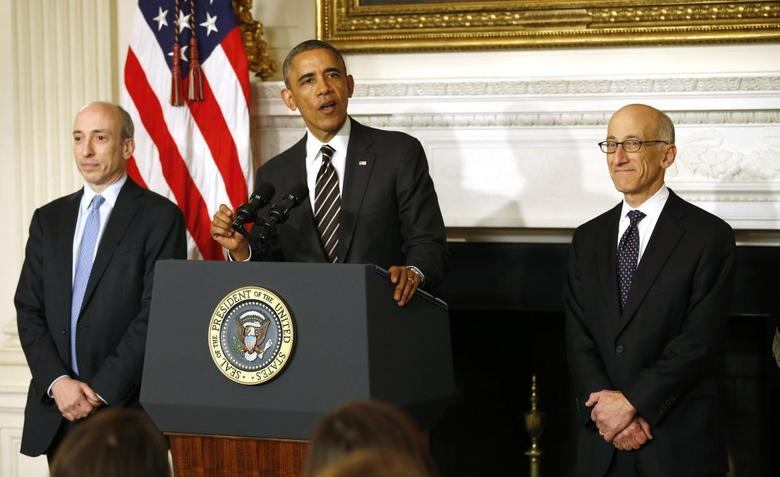 U.S. President Barack Obama nominates Timothy Massad (R) as Chairman of the Commodity Futures Trading Commission (CFTC) at the White House in Washington November 12, 2013. REUTERS/Kevin Lamarque