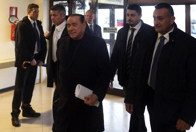 Leader of Forza Italia party Silvio Berlusconi (C) arrives at Ciampino Airport in Rome, March 25, 2014. REUTERS/Alessandro Bianchi
