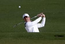 Northern Ireland's Rory McIlroy hits from the sand onto the second green during a practice round ahead of the Masters golf tournament at the Augusta National Golf Club in Augusta, Georgia April 8, 2014. REUTERS/Mike Segar