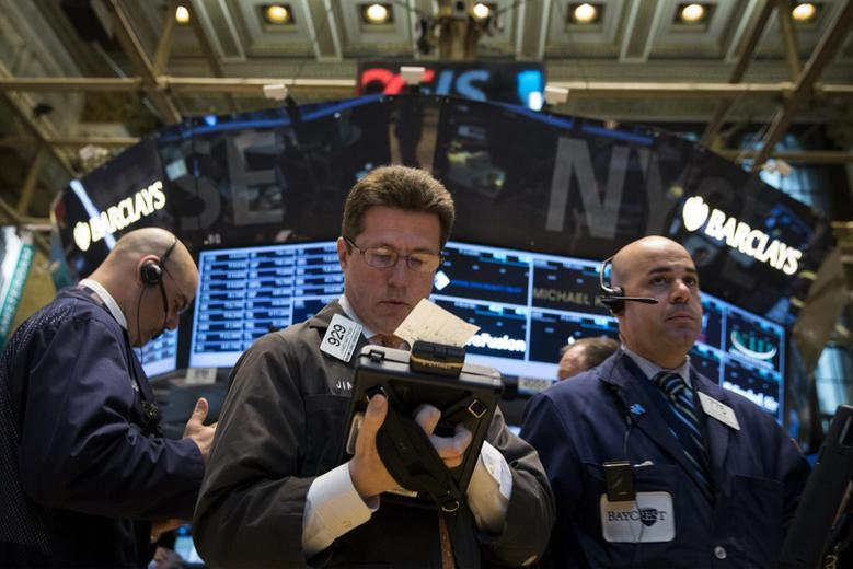 Traders work on the floor of the New York Stock Exchange April 7, 2014. REUTERS/Brendan McDermid