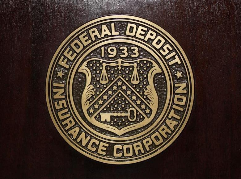 The Federal Deposit Insurance Corp (FDIC) logo is seen at the FDIC headquarters as Chairman Sheila Bair announces the bank and thrift industry earnings for the fourth quarter 2010, in Washington, February 23, 2011. REUTERS/Jason Reed