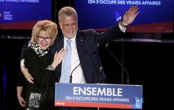 Quebec Liberal leader Philippe Couillard takes the stage with his wife Suzanne Pilote at his rally headquarters after his in St. Felicien, Quebec, April 7, 2014. REUTERS/Mathieu Belanger