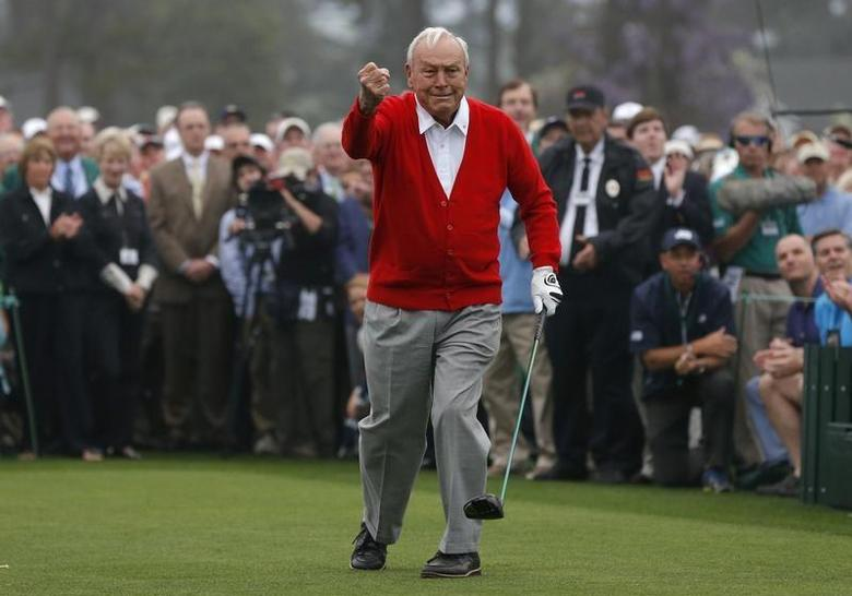 Arnold Palmer of the U.S. reacts after hitting his tee shot during the ceremonial start for the 2013 Masters golf tournament at the Augusta National Golf Club in Augusta, Georgia in this April 11, 2013 file photo. REUTERS/Phil Noble