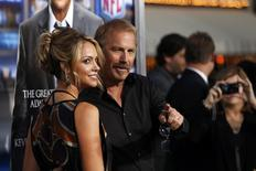 "Cast member Kevin Costner and his wife Christine Baumgartner pose at the premiere of ""Draft Day"" in Los Angeles, California April 7, 2014. REUTERS/Mario Anzuoni"