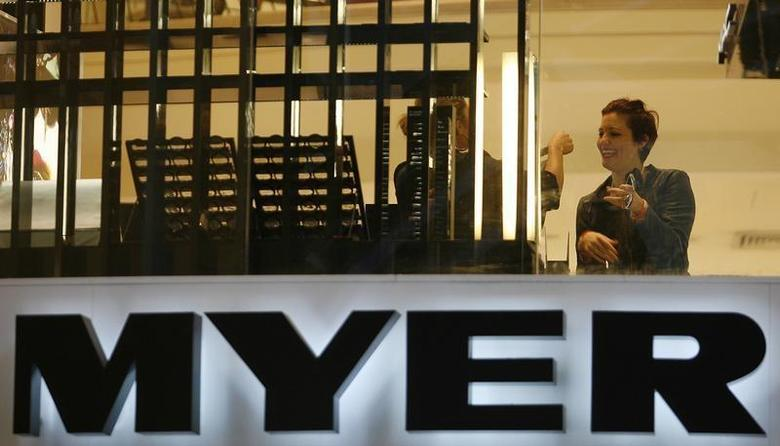 A customer smiles as she shops at a Myer store in central Sydney August 25, 2009. REUTERS/Daniel Munoz