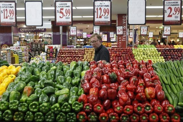 A customer walks through the fruits and vegetables section at a supermarket in Sydney April 27, 2011. REUTERS/Daniel Munoz
