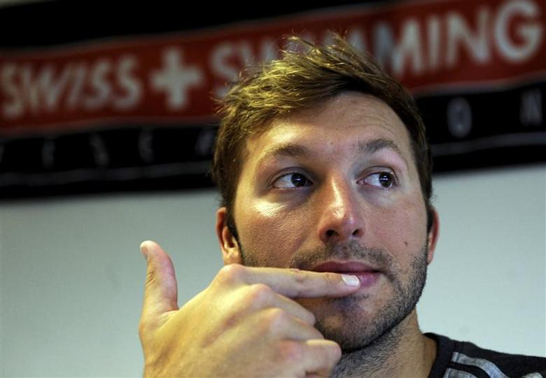 Australian swimmer Ian Thorpe gestures during a news conference in the southeastern village of Tenero in this March 16, 2011 file photo. REUTERS/Fiorenzo Maffi/Files