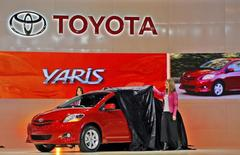 Toyota representatives unveil the 2007 Yaris S Sedan as the car makes its global debut at the 2006 Los Angeles Auto Show in Los Angeles, California in this January 4, 2006 file photo. REUTERS/Lucas Jackson/Files