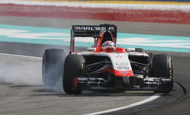 Marussia Formula One driver Jules Bianchi of France brakes as he takes a corner during the Malaysian F1 Grand Prix at Sepang International Circuit outside Kuala Lumpur, March 30, 2014. REUTERS/Edgar Su
