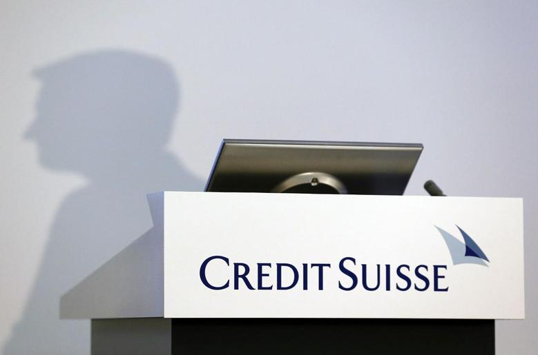 The shadow of Brady W. Dougan, CEO of Credit Suisse, is pictured before the full year results conference in Zurich February 6, 2014. REUTERS/Denis Balibouse