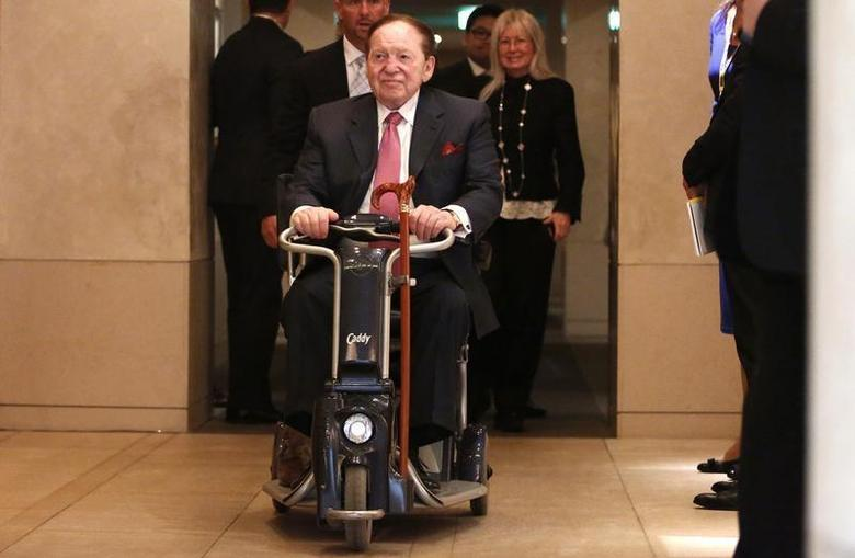 Las Vegas Sands Corp Chairman and Chief Executive Officer Sheldon Adelson rides his wheelchair after a news conference in Tokyo February 24, 2014. REUTERS/Yuya Shino