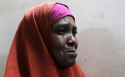 A suspected Somali illegal migrant arrested in a police swoop cries as she prepares to be processed for deportation at a holding station in Kenya's capital Nairobi, April 9, 2014. REUTERS/Thomas Mukoya
