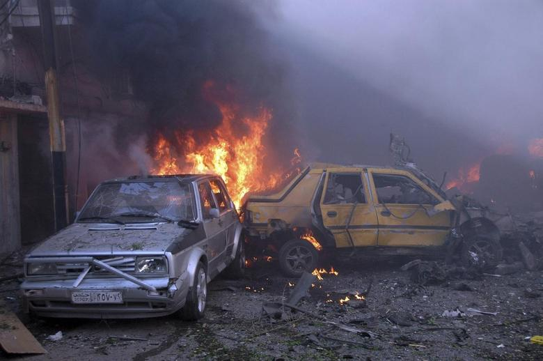 Cars burn after two car bombs at Karm al-Louz neighbourhood in Homs city, April 9, 2014, in this handout released by Syria's national news agency SANA. REUTERS/SANA/Handout via Reuters
