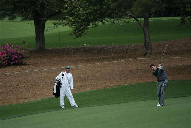 Three time champion Nick Faldo hits on the ninth fairway during a practice round before the Masters golf tournament at the Augusta National Golf Club in Augusta, Georgia April 6, 2014. REUTERS/Mike Blake