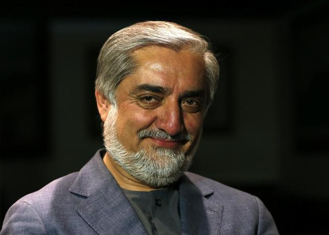 Afghan presidential candidate and former foreign minister Abdullah Abdullah smiles during an interview in Kabul April 9, 2014. REUTERS/Mohammad Ismail