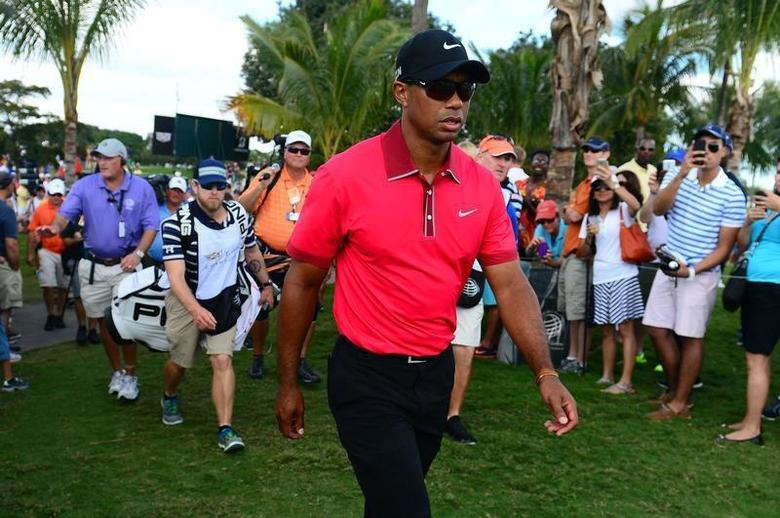 Mar 9, 2014; Miami, FL, USA; Tiger Woods walks to the 5th tee during the final round of the WGC - Cadillac Championship golf tournament at TPC Blue Monster at Trump National Doral. Andrew Weber-USA TODAY Sports