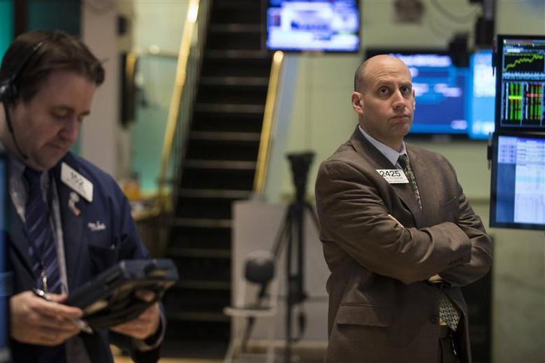 Traders work on the floor of the New York Stock Exchange April 9, 2014. REUTERS/Brendan McDermid