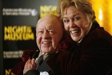 "Actor Mickey Rooney (L) and his wife Janice arrive at the American Museum of Natural History for the premiere of the movie ""Night at the Museum"" in New York in this file photo taken December 17, 2006. REUTERS/Eric Thayer"
