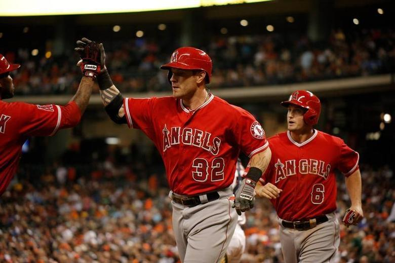Apr 5, 2014; Houston, TX, USA; Los Angeles Angels left fielder Josh Hamilton (32) high-fives second baseman Howie Kendrick (47) after hitting a three-run home run during the fifth inning against the Houston Astros at Minute Maid Park. Andrew Richardson-USA TODAY Sports