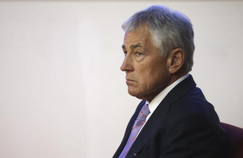 U.S. Secretary of Defense Chuck Hagel waits to be introduced prior to his speech at the National Defense University in Beijing April 8, 2014. REUTERS/Alex Wong/Pool