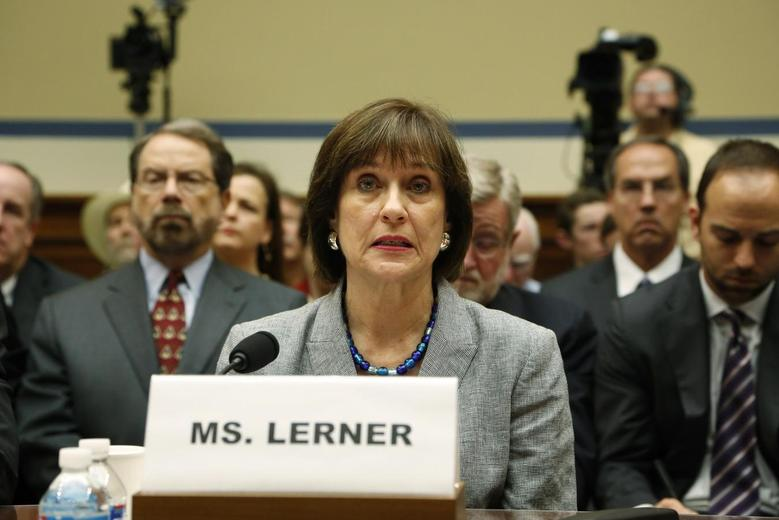 Director of Exempt Organizations for the Internal Revenue Service (IRS) Lois Lerner prepares to deliver an opening statement to a House Oversight and Government Reform Committee hearing on alleged targeting of political groups seeking tax-exempt status from by the IRS, on Capitol Hill in Washington, May 22, 2013. REUTERS/Jonathan Ernst