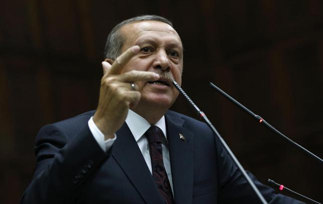 Turkey's Prime Minister Tayyip Erdogan addresses members of parliament from his ruling AK Party (AKP) during a meeting at the Turkish parliament in Ankara April 8, 2014. REUTERS/Umit Bektas