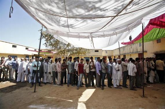 Men stand in a line to cast their vote outside a polling station during the general election, in Shahpur in Muzaffarnagar district of Uttar Pradesh April 10, 2014. REUTERS/Anindito Mukherjee