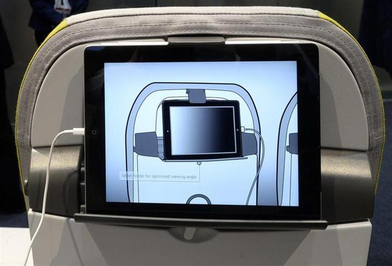 A tablet computer holder installed in the back of an airline seat is displayed at the Recaro booth during the Aircraft Interiors Expo in Hamburg, April 8, 2014. REUTERS/Fabian Bimmer
