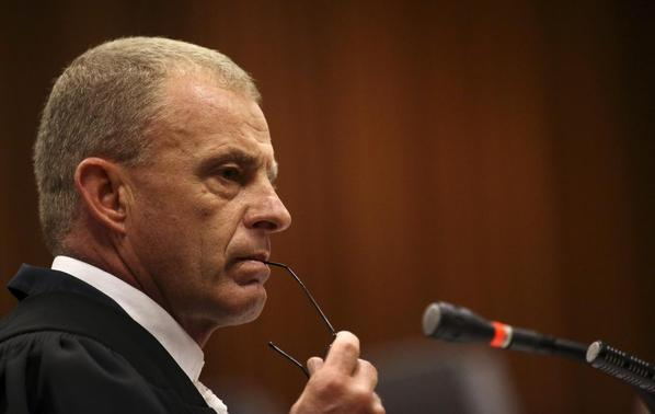 State prosecutor Gerrie Nel looks on as he cross-examines South African Olympic and Paralympic sprinter Oscar Pistorius during his trial at the North Gauteng High Court in Pretoria April 9, 2014. REUTERS-Siphiwe Sibeko