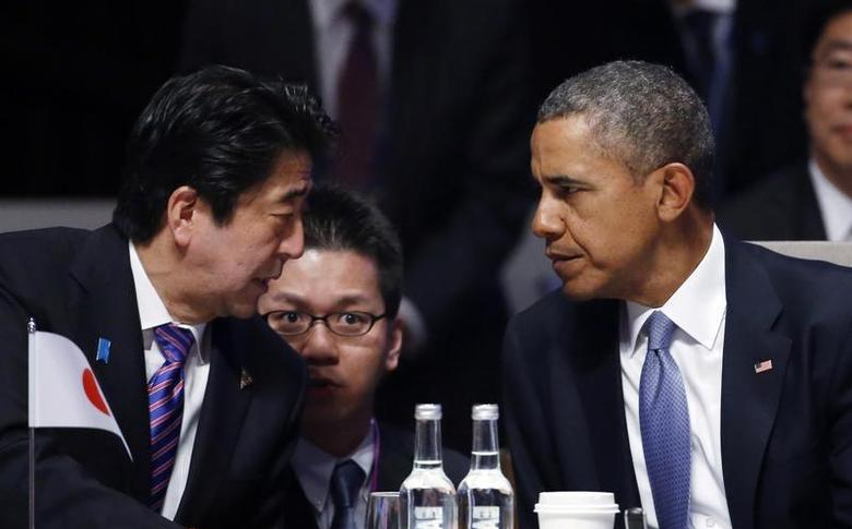 Japan's Prime Minister Shinzo Abe talks to U.S. President Barack Obama (R) during the opening session of the Nuclear Security Summit in The Hague March 24, 2014. REUTERS/Yves Herman