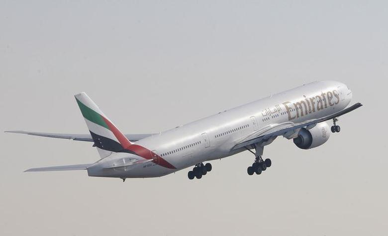 An Emirates Airlines Boeing 777-300 aircraft takes off during the second day of the Dubai Airshow November 14, 2011. REUTERS/Nikhil Monteiro