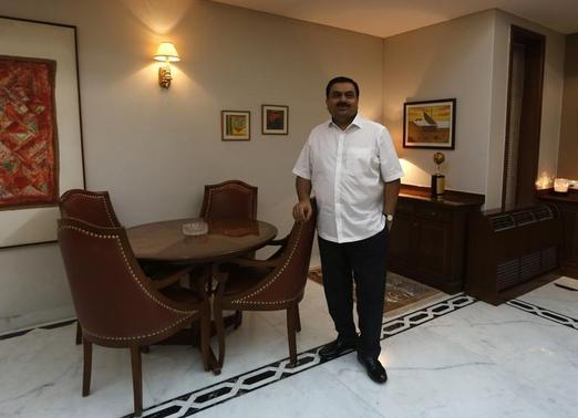 Indian billionaire Gautam Adani poses for a picture after an interview with Reuters at his office in Ahmedabad April 2, 2014. REUTERS/Amit Dave