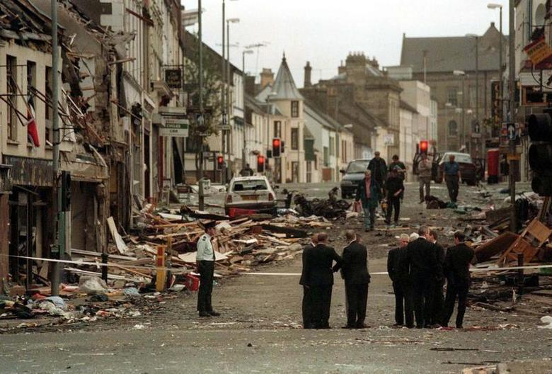 Police stand in the rubble after a car-bomb ripped through the market town of Omagh in Northern Ireland August 15, 1998.  REUTERS/File