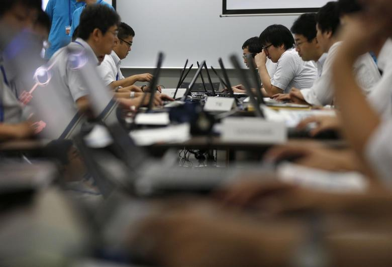 Participants from government ministries and agencies take part in the Cyber Defense Exercise with Recurrence (CYDER) in Tokyo September 25, 2013. REUTERS/Toru Hanai