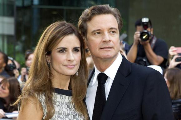 British actor Colin Firth arrives with his wife Livia Giuggioli of Italy for the film premiere of ''Railway Man'' at the 38th Toronto International Film Festival in Toronto September 6, 2013. REUTERS/Fred Thornhill
