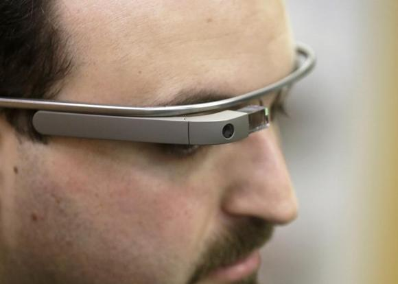 Developer Maximiliano Firtman wears the prototype device Google Glass before a news conference ahead of the 2013 RigaComm event in Riga November 4, 2013. RigaComm will run from November 22 to 24. REUTERS/Ints Kalnins