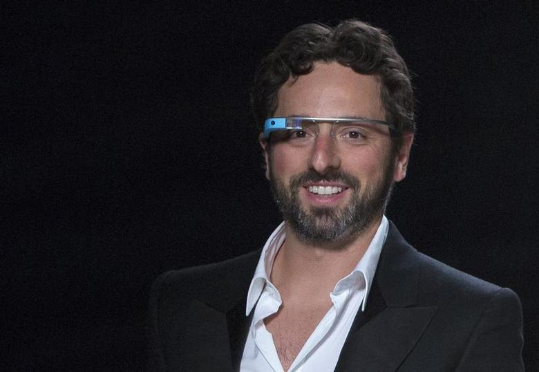 Google co-founder Sergey Brin walks the runway wearing new product ''Glass by Google'' after the Diane von Furstenberg Spring/Summer 2013 collection show during New York Fashion Week September 9, 2012. REUTERS/Andrew Kelly