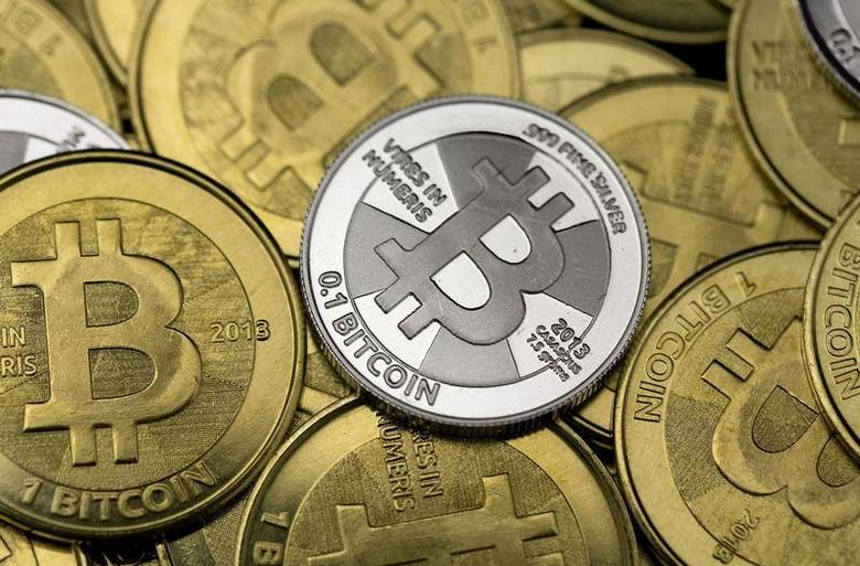 Some of Bitcoin enthusiast Mike Caldwell's coins are pictured at his office in this photo illustration in Sandy, Utah, January 31, 2014. REUTERS/Jim Urquhart/Files