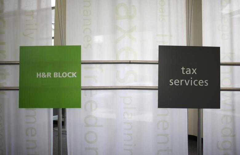 Signs at a H&R Block office are seen in Chicago April 14, 2009. REUTERS/John Gress