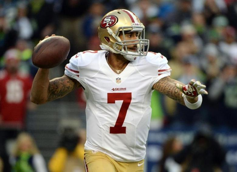Jan 19, 2014; Seattle, WA, USA; San Francisco 49ers quarterback Colin Kaepernick (7) drops back to pass against the Seattle Seahawks during the first half of the 2013 NFC Championship football game at CenturyLink Field. Kyle Terada-USA TODAY Sports - RTX17LV3