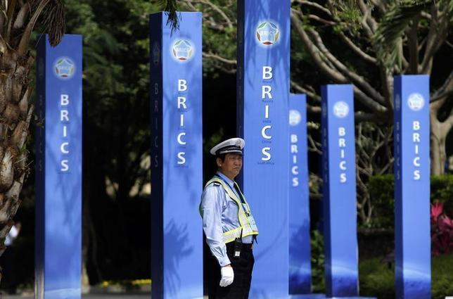 A traffic policeman stands on duty outside the Sheraton Hotel, the venue of BRICS Summit in Sanya, China's Hainan province, April 13, 2011. REUTERS/Jason Lee/Files