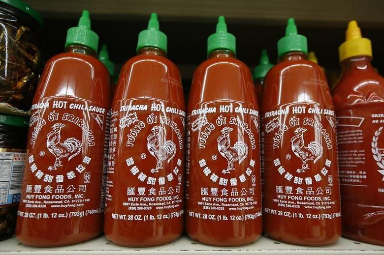 Bottles of Sriracha hot chili sauce, made by Huy Fong Foods, are seen on a supermarket shelf in San Gabriel, California October 30, 2013. REUTERS/Lucy Nicholson