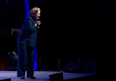 Hillary Clinton dodges shoe during Las Vegas speech