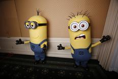 "Two life-size minion characters wait for actor Steve Carell to arrive while promoting his upcoming movie ""Despicable Me 2"" in Los Angeles, California June 14, 2013. REUTERS/Mario Anzuoni"