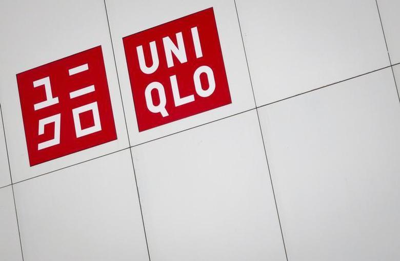 The Uniqlo store logo is pictured on the side of the 5th Ave Flagship store in the Manhattan borough of New York February 21, 2014. REUTERS/Carlo Allegri