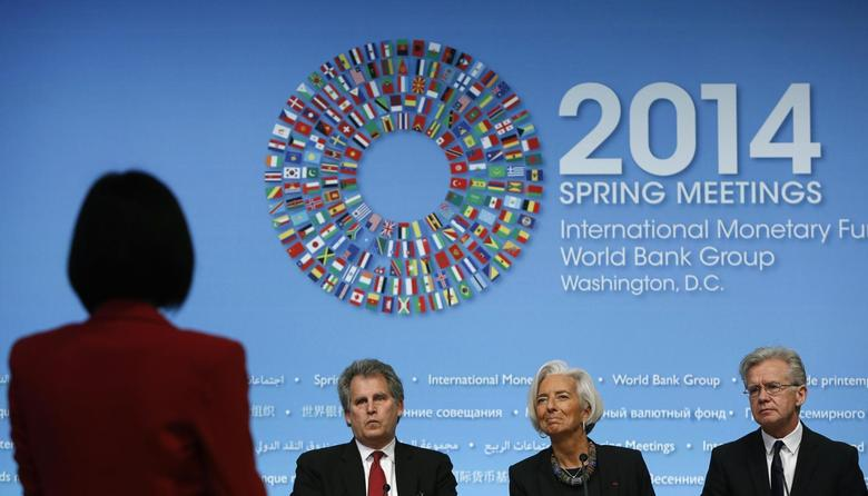 International Monetary Fund (IMF) Managing Director Christine Lagarde (2nd R) takes a question during a news conference in Washington April 10, 2014. REUTERS/Gary Cameron